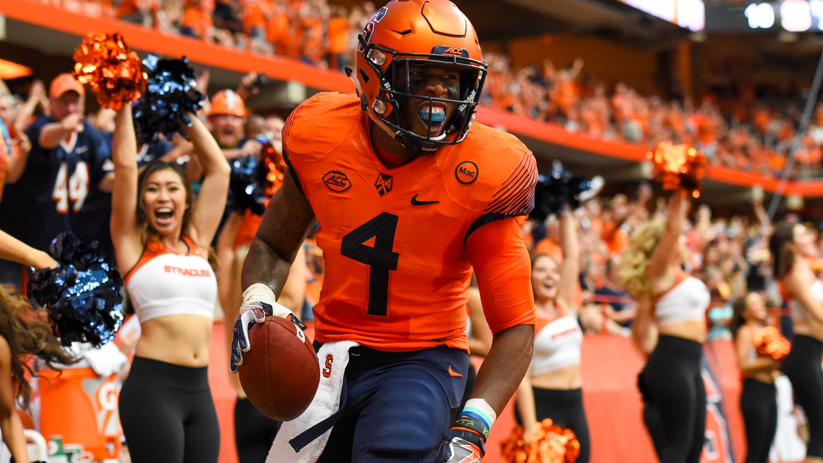 Sep 16, 2017; Syracuse, NY, USA; Syracuse Orange running back Dontae  Strickland (4) celebrates his touchdown run against the Central Michigan  Chippewas ...