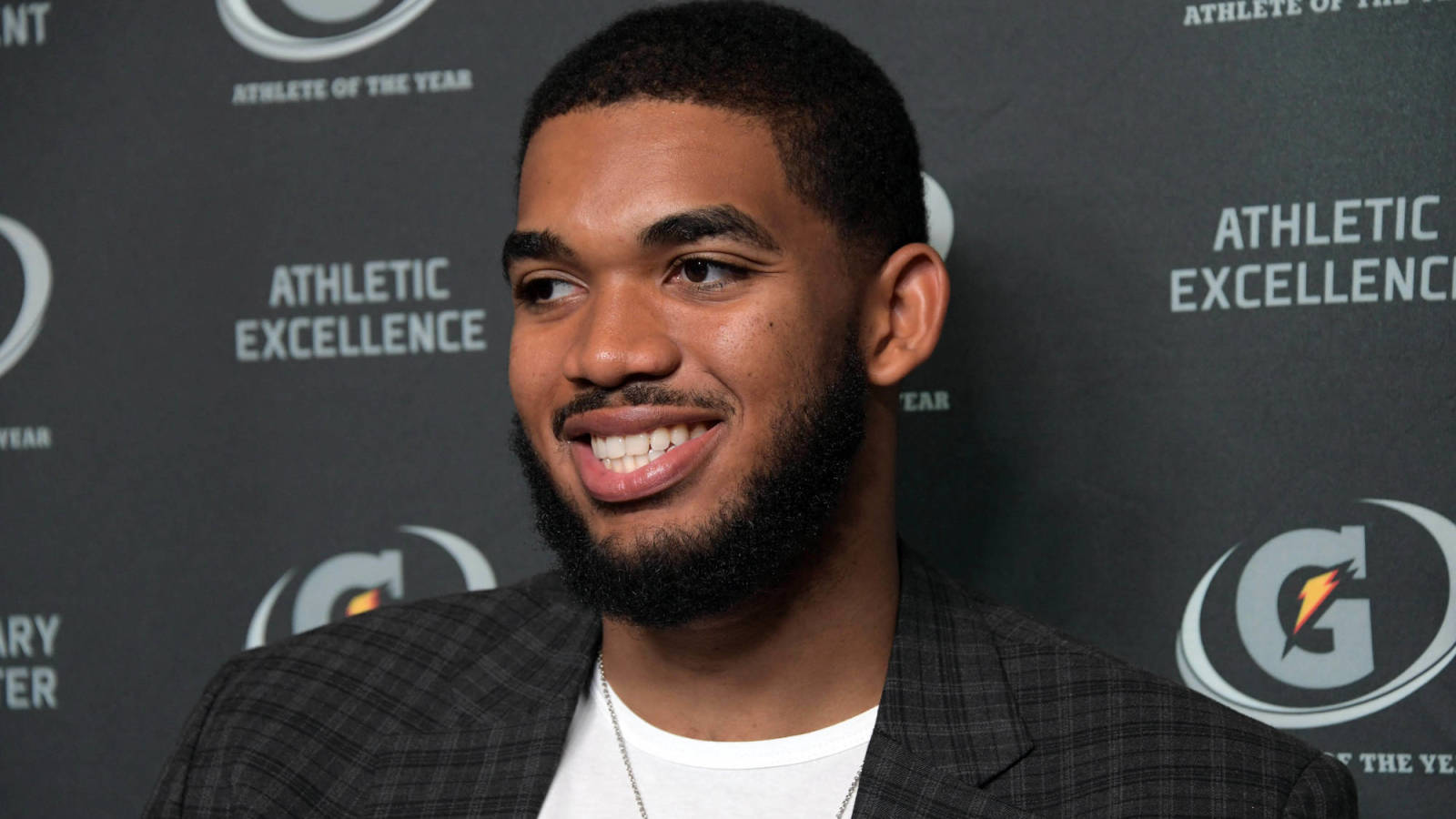 Karl-Anthony Towns jokes with John Calipari after contract news