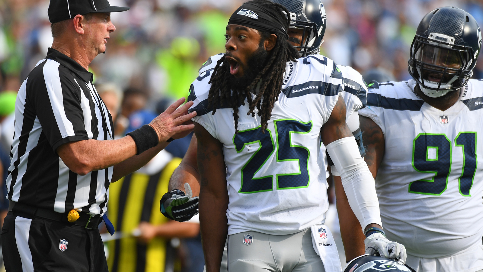 Fight breaks out after Richard Sherman lands cheap shot on Marcus
