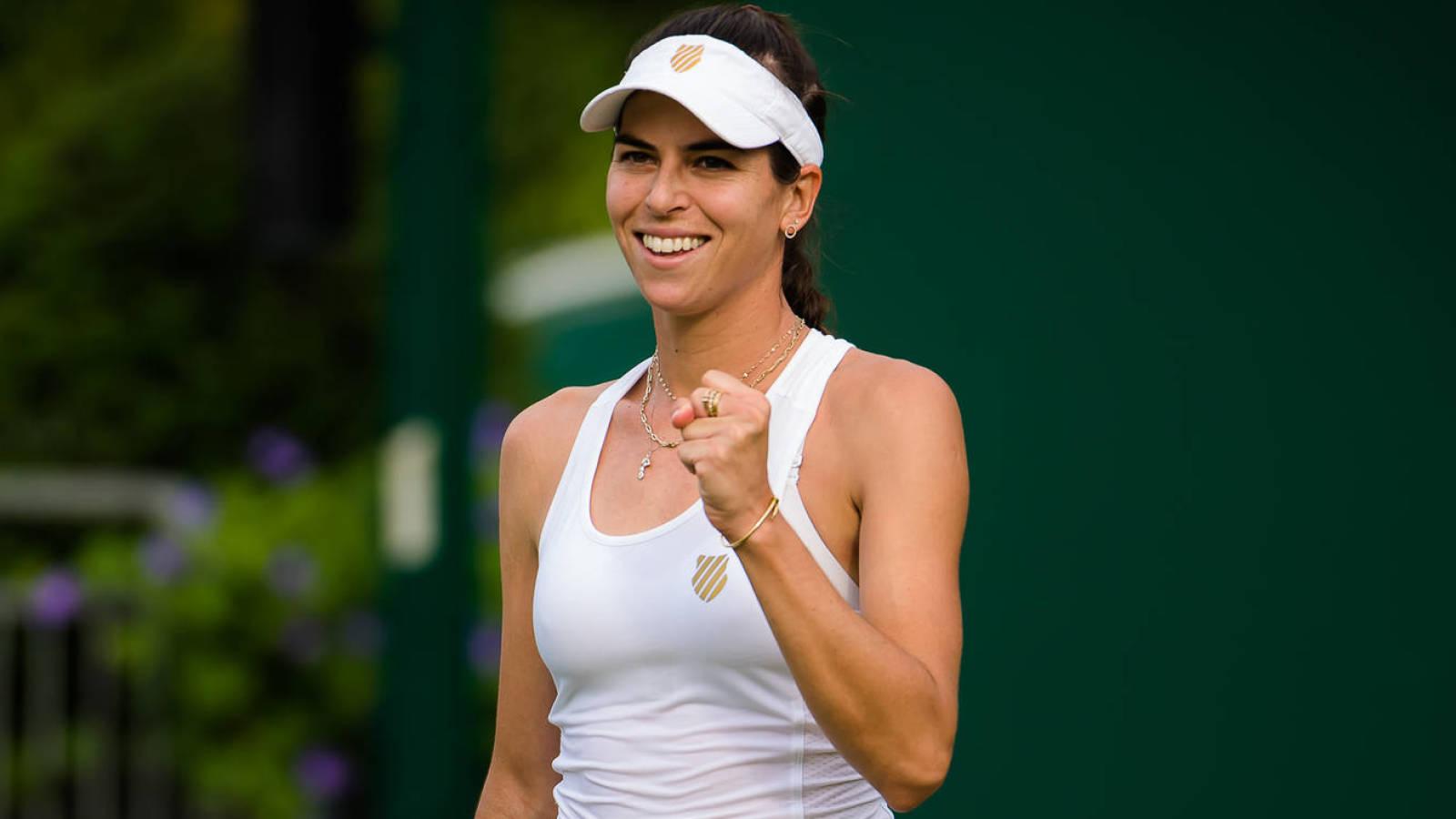Ajla Tomljanovic and Jelena Ostapenko enter the game at Wimbledon