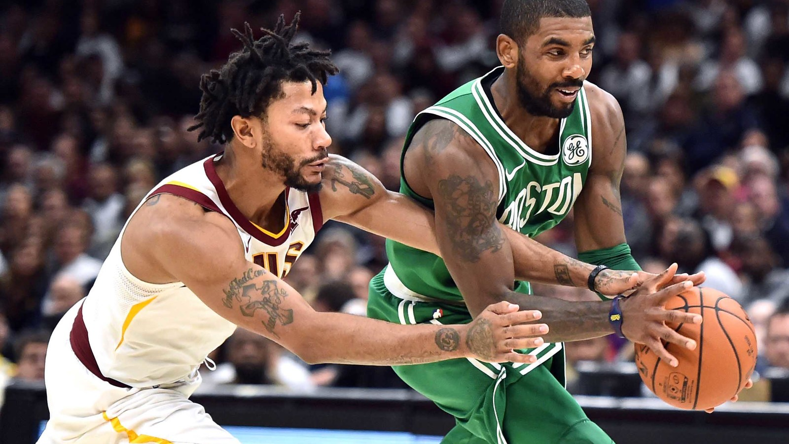 97f0fadd53ba Cleveland Cavaliers guard Derrick Rose challenges Irving for the ball  during as Irving returned the Q on the opening night of the 2017-2018 NBA  season.
