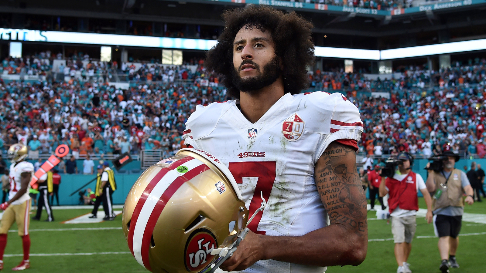 Colin Kaepernick's mom fires back after Urban Meyer's wife criticizes QB