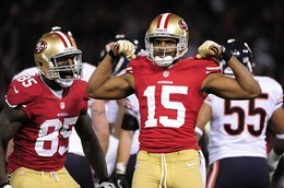 November 19, 2012; San Francisco, CA, USA; San Francisco 49ers wide receiver Michael Crabtree (15) celebrates after a play with tight end Vernon Davis (85) during the second quarter against the Chicago Bears at Candlestick Park. Mandatory Credit: Kyle Terada-USA TODAY Sports...