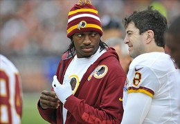 Dec 16, 2012; Cleveland, OH, USA;Washington Redskins quarterback Robert Griffin III (left) talks with Washington Redskins quarterback Rex Grossman (8) in the first quarter against the Cleveland Browns at Cleveland Browns Stadium. Mandatory Credit: David Richard-USA TODAY Sports...