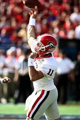 Jan 1, 2013; Orlando, FL, USA; Georgia Bulldogs quarterback Aaron Murray (11) throws a touchdown pass to wide receiver Tavarres King (not pictured) against the Nebraska Cornhuskers during the first quarter of the 2013 Capital One Bowl at the Citrus Bowl. Mandatory Credit: Douglas Jones-USA TODAY Sports...