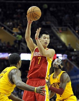Jan 5, 2013; Cleveland, OH, USA; Houston Rockets point guard Jeremy Lin (7) passes against Cleveland Cavaliers point guard Kyrie Irving (right) in the first quarter at Quicken Loans Arena. Mandatory Credit: David Richard-USA TODAY Sports...