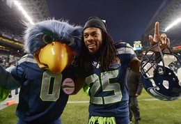 Dec 9, 2012; Seattle, WA, USA; Seattle Seahawks cornerback Richard Sherman (25) poses with Seahawks mascot Blitz after the game against the Arizona Cardinals at CenturyLink Field. The Seahawks defeated the Cardinals 58-0. Mandatory Credit: Kirby Lee/Image of Sport-USA TODAY Sports...