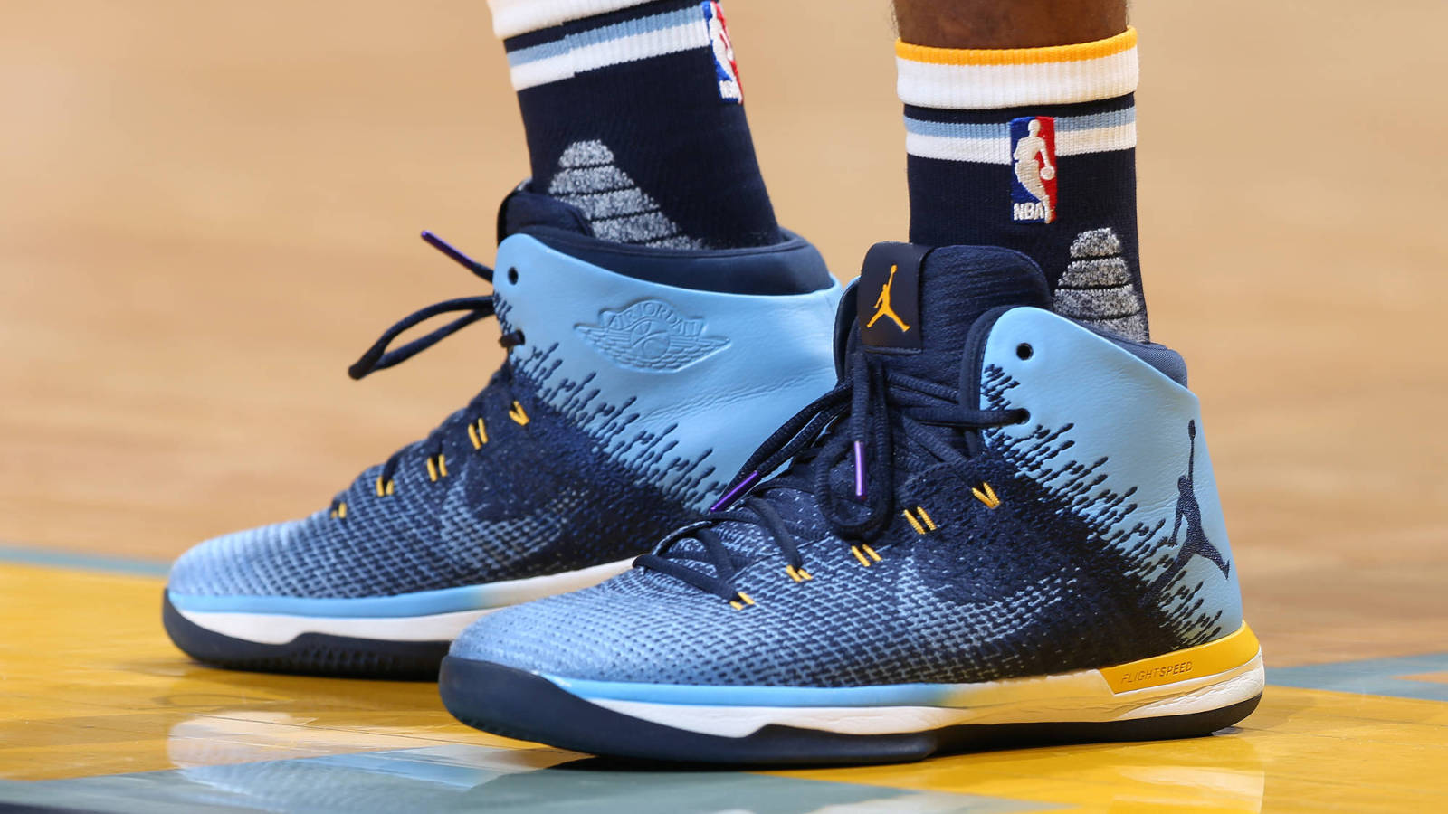 The shades of blue mixed with yellow on Mike Conley's PEs are Grizzlies  through and through. Joe Murphy/Getty Images