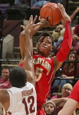 Jan 17, 2012; Tallahassee, FL, USA; Maryland Terrapins guard Nick Faust (5) shoots over Florida State Seminoles point guard Jeff Peterson (12) in the second half of their game at the Donald L. Tucker Center. Florida State won 84-70. Mandatory Credit: Phil Sears-USA TODAY Sports...