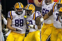 Dec 31, 2012; Atlanta, GA, USA; LSU Tigers running back Jeremy Hill (33) celebrates with tight end Chase Clement (88) after a touchdown in the first half against the Clemson Tigers during the Chick-fil-A Bowl at the Georgia Dome. Mandatory Credit: Daniel Shirey-USA TODAY Sports...